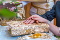 Engagement rings at the hands of the newlyweds Stock Photo