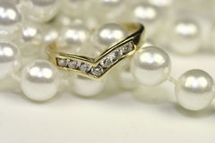 Engagement rings and pearls Royalty Free Stock Photo