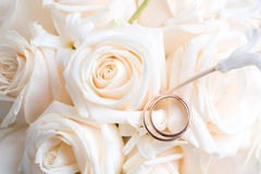 Engagement Rings on roses. Wedding Rings on roses bouquet Royalty Free Stock Photo