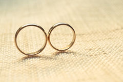Engagement rings. Two engagement rings on cloth texture - wedding rings Stock Photos