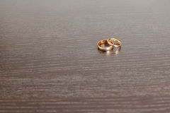 Engagement rings. Wedding rings on wooden surface Stock Photography