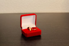 Engagement rings. Wedding rings on wooden surface Stock Image