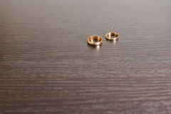 Engagement rings. Wedding rings on wooden surface Royalty Free Stock Images