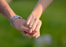 Engagement. Two hands holding each other - stock photo Royalty Free Stock Image