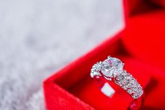 Engagement wedding diamond ring in jewelry gift box royalty free stock photos