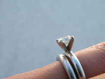 Engagement and wedding ring. Detail of engagement and wedding rings on a woman's hand Royalty Free Stock Image
