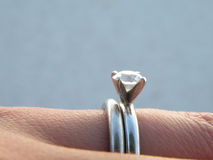 Engagement and wedding ring. Detail of engagement and wedding rings on a woman's hand Stock Photography