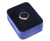 Engagement wedding ring in on velvet box. Blue Stock Photography