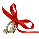 Engagement and wedding rings tied with red ribbon Stock Photo