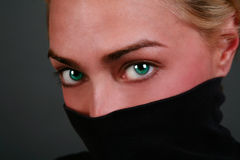 Engaging eyes. Mysterious and engaging portrait of woman with beautiful eyes Royalty Free Stock Photography
