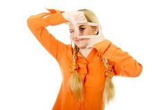 Engaging girl in orange clothes Stock Image