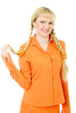 Engaging girl in orange clothes Royalty Free Stock Images