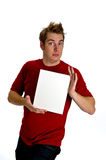 Engaging Young Man holding a blank white sign Royalty Free Stock Photography