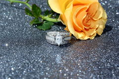 Engarement Ring. Diamond engagement ring with a peach colored rose stock photography