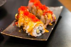 Engawa sushi på den svarta plattan Royaltyfri Bild