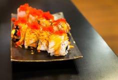 Engawa sushi på den svarta plattan Royaltyfri Fotografi