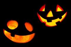 Enge gezichten van Halloween-pompoenen Stock Foto's