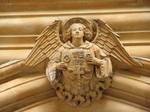 Engel auf dem Bogen mit Schild Lizenzfreie Stockbilder