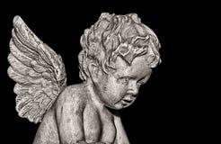 Engel auf Schwarzem Stockfoto