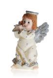 Engel, der auf einer Flöte spielt Stockbild
