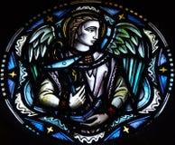 Engel, der einen Anker hält lizenzfreie stockbilder