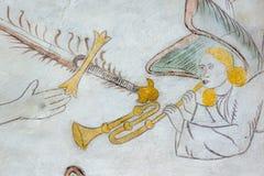 Engel die de trompet, middeleeuws muurschilderij spelen Royalty-vrije Stock Afbeeldingen