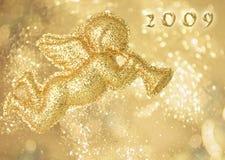 Engel, ein goldener Hintergrund Stockbild