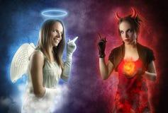 Engel en het concept van de Duivel Stock Afbeelding