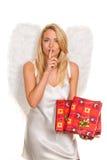 Engel für Weihnachten mit Paketen und Geschenken. Stockfotografie
