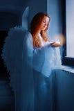 Engel met een kaars stock foto's