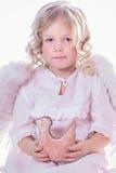 Engel met een stuk speelgoed Royalty-vrije Stock Afbeelding