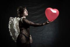 Engel met hart stock afbeeldingen