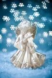 Engel mit blauem Feiertags-Hintergrund Stockbilder
