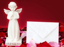 Engel und Buchstabe des Trostes Stockfoto