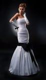 Engelachtige bruidblonde in bruids kleding Stock Foto's
