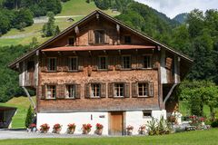 Traditional wooden chalet at Engelberg on the Swiss alps. Engelberg, Switzerland - 12 July 2017: traditional wooden chalet at Engelberg on the Swiss alps Royalty Free Stock Images