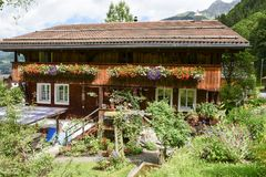 Traditional wooden chalet at Engelberg on the Swiss alps. Engelberg, Switzerland - 12 July 2017: traditional wooden chalet at Engelberg on the Swiss alps Stock Photography
