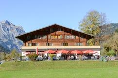 Wooden chalet restaurant at Engelberg on the Swiss alps. Engelberg, Switzerland - 15 October 2017: people eating and drinking in a wooden chalet restaurant at Stock Photo