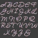 Engels alfabet van waterverf roze en purpere bloemen Royalty-vrije Stock Afbeeldingen