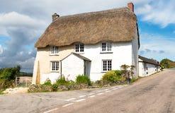 Engels met stro bedekt plattelandshuisje Stock Foto's