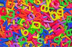 Engelse alfabet en aantalachtergrond Royalty-vrije Stock Foto's