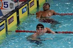 Engelse concurrerende zwemmer Benjamin TROTSE GBR en SHIOURA Shinri JPN Stock Foto