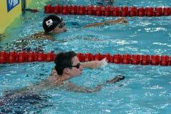 Engelse concurrerende zwemmer Benjamin TROTSE GBR en SHIOURA Shinri JPN Stock Afbeeldingen