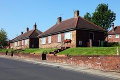 Engelse Redbrick Huizen Stock Afbeelding