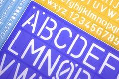 Engelska märker plast- stencilalfabet Royaltyfri Fotografi