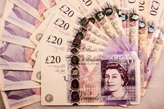 Engelska tjugo pund ett pund sterlingpengarblandning arkivfoto