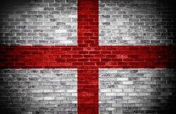 Engelskaflagga över tegelsten Arkivfoto
