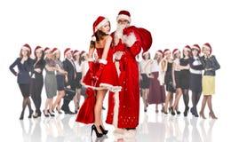 Engendre la helada y a la mujer en vestido rojo de Navidad Fotografía de archivo