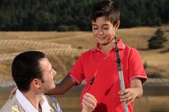 Père avec le fils et le temps gratuit Image libre de droits