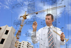 Engeneer-designer. The of engeneer-designer is carried out by construction plans Royalty Free Stock Images